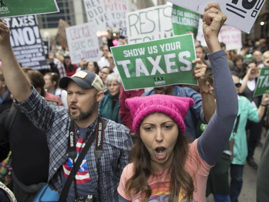Demonstrators march in New York City Saturday to demand President Donald Trump release his tax returns. Protesters took to the streets in dozens of cities nationwide.