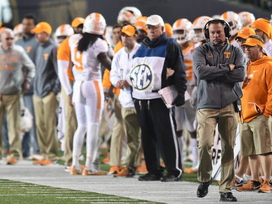 Tennessee coach Butch Jones watches the action during the second half of the Vols' game against Vanderbilt in Nashville on Nov. 26, 2016.