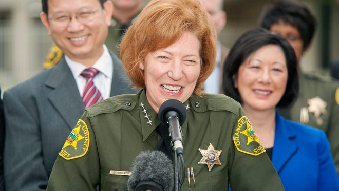 Orange County Sheriff Sandra Hutchens is all smiles as she answers questions about the capture of both outstanding jail escapees Hossein Nayeri and Jonathan Tieu are in the custody of the San Francisco during a news conference outside Orange County Sheriff's Department headquarters in Santa Ana on Saturday, Jan. 30, 2016. (Ken Steinhardt/The Orange County Register via AP)