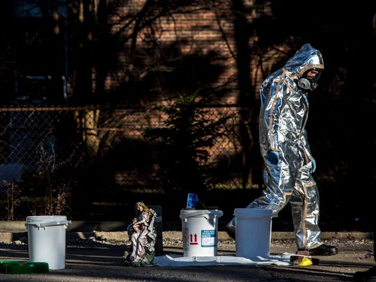 Members of the Port Huron Police Department work to dismantle a meth lab Tuesday, Feb. 14, 2017 at 1040 Chestnut St. in Port Huron.