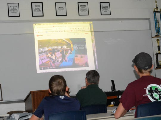 Civilian Marksmanship Program Clinic participants watch a YouTube clip from the 2016 International Shooting Sports Federation World Cup Finals in Munich, Germany, as part of the curriculum Saturday at Piedra Vista High School.