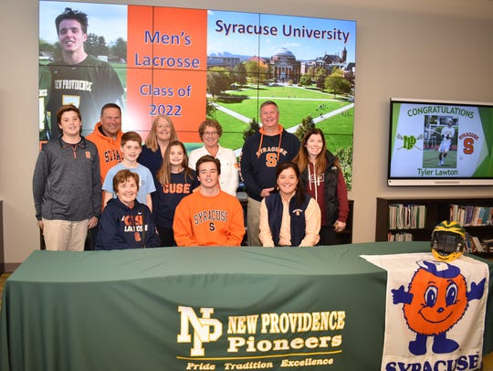 New Providence's Tyler Lawton signs his National Letter