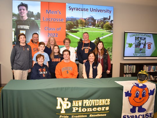 New Providence's Tyler Lawton signs his National Letter of Intent.
