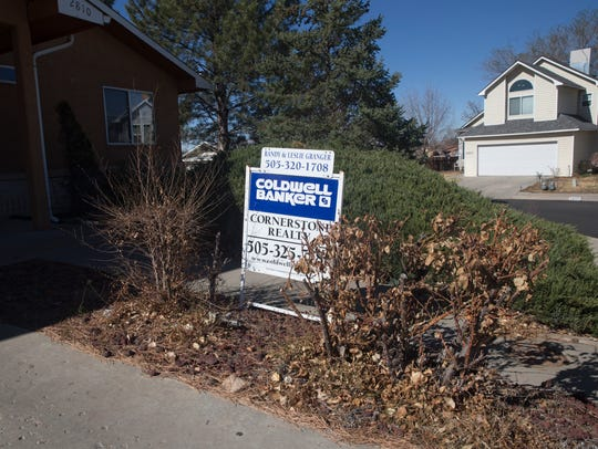 A for sale sign is posted in front of a home in the 2800 block of Eastridge Court in Farmington. Nearly 840 homes were sold in San Juan County last year.