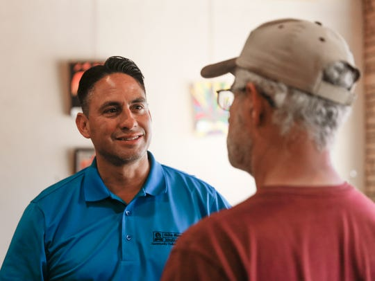 Lieutenant governor candidate Howie Morales talks with Matt Dodson during a meet-and-greet session with members of the San Juan County Democratic Party Thursday at the Chile Pod in Farmington.