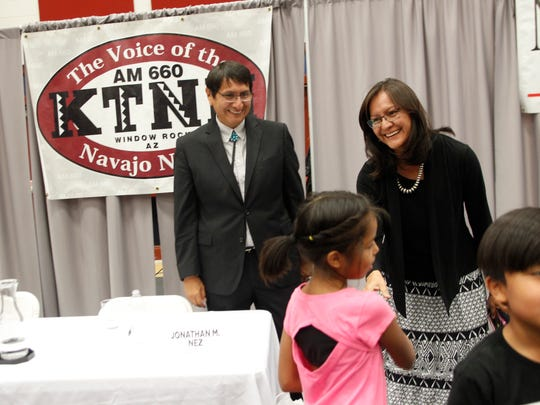 Jonathan Nez and his wife Phefelia Herbert-Nez shake hands with community members Monday after a Navajo Nation presidential candidates forum at Navajo Technical University in Crownpoint.