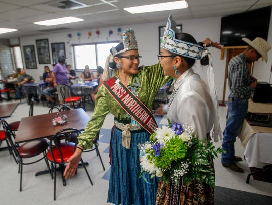 Miss Northern Navajo Ariana Roselyn Young, left, reaches