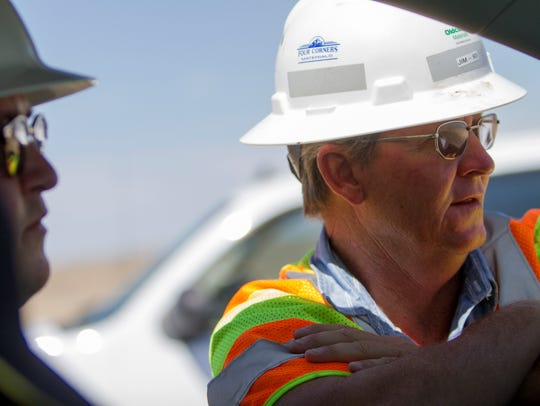 Carl Slater, manager at the Navajo Division of Transportation's Department of Airports Management, left, talks with Jim Ratliff, area superintendent for Four Corners Materials, during renovation work Wednesday at the Shiprock Airstrip.
