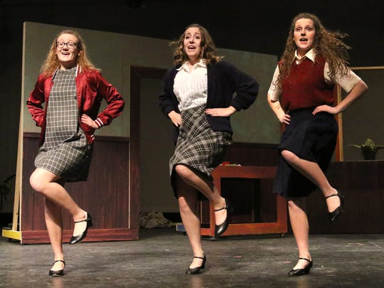 """Laura Laberge (left), Clair Vock and Grace McMahon perform as the street urchins throughout the Kettle Moraine Perform's production of """"Little Shop of Horrors."""""""