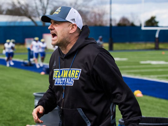 Head coach Danny Rocco yells to his players during a drill change at spring practices for the University of Delaware football team at the University of Delaware in Newark on Tuesday afternoon.