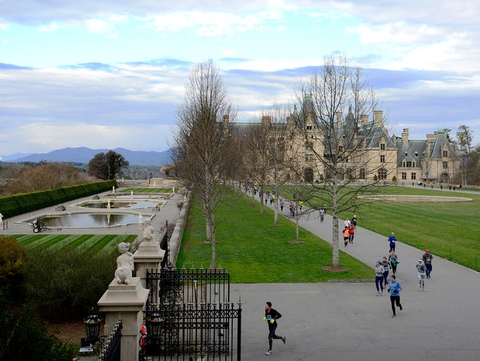 Runners make their way around the Biltmore House and
