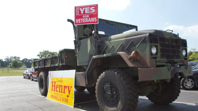 A military transport vehicle was parked in the parking lot outside the polls in Hartland to draw attention to the ballot proposal for veterans' services, as well as to campaign for County Prosecutor candidate Carolyn Henry.