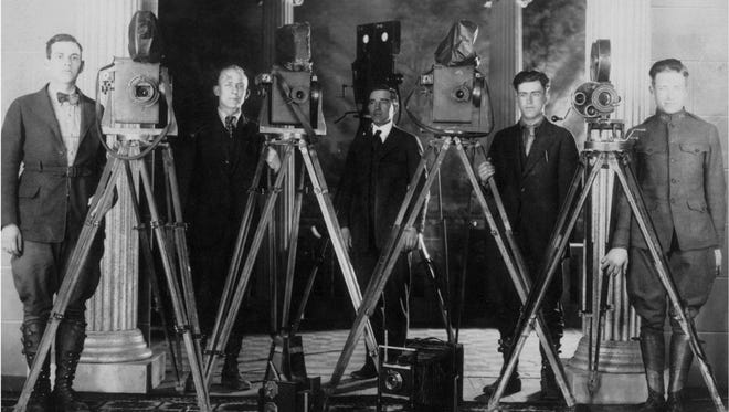 John Holbrook is in the center of portrait of cameramen that worked for the Wharton brothers making silent movies in Ithaca.