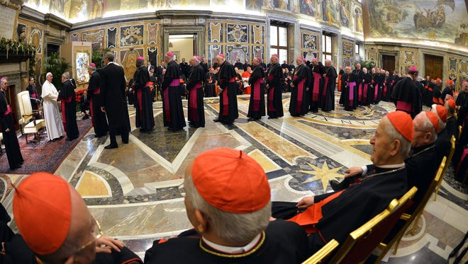 Pope Francis meets with cardinals and bishops of the Vatican Curia during a meeting on the occasion of the exchange of Christmas greetings in the Clementine hall at Vatican on Monday, Dec. 22, 2014.