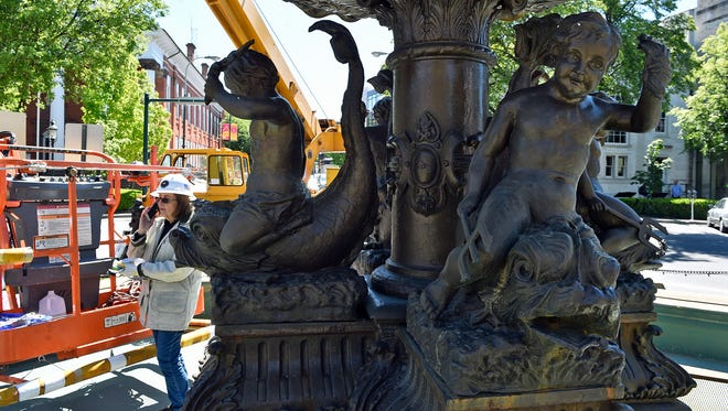 "ART Research Enterprises, is doing maintenance work on Chambersburg Memorial Fountain, Tuesday, May, 9, 2017, said Becky Ault, one of the Lancaster company's primary owners. Borough officials were not satisfied with the water pressure at some nozzles and called the company that refurbished the fountain last year, according to Assistant Borough Manager David Finch. A piece on the interior apparently is rusting and ""painting "" the fountain with a rusty coat. A major repair is not expected and the fountain should be turned on as scheduled on May 19. Traffic was funneled to a single lane on both Lincoln Way and Main Street."