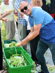 Visiting writers such as Vladimir Martinovski of Macedonia delighted in helping to husk corn for the big annual farm feast hosted by the Dane family of Iowa City this fall.