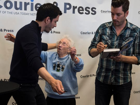 """Mary Ann Schuessler, middle, of Eddyville, Ky. meets HGTV stars the """"Property Brothers"""" Drew Scott, left, and Jonathan Scott, right, during the Home Show at the Old National Events Plaza on Sunday, April 8, 2018."""