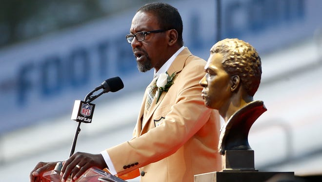 Former Seattle Seahawks player Kenny Easley speaks next a bust of himself during his induction ceremony at the Pro Football Hall of Fame Saturday in Canton, Ohio.