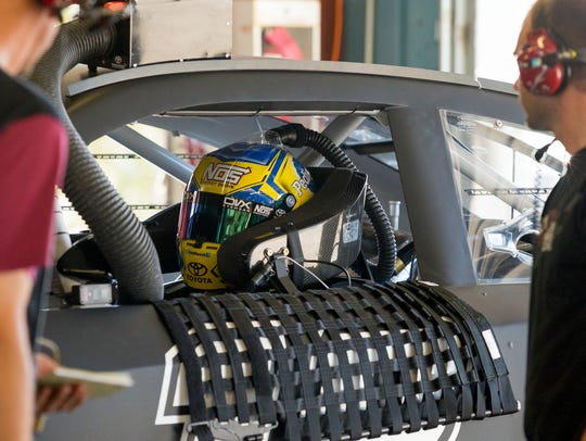 Kyle Busch prepares to go back out on to the track