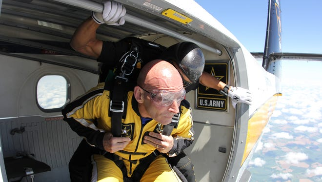 Retired Army Lt. Gen. Keith M. Huber is senior adviser for veterans and leadership initiatives at MTSU. He is shown preparing to tandem jumps from the plane with a member of the Army Golden Knights during a 2017 visit for Fort Campbell.