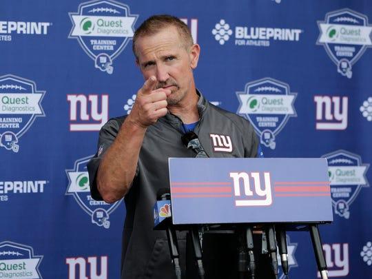 Giants defensive coordinator Steve Spagnuolo will take over as interim head coach.