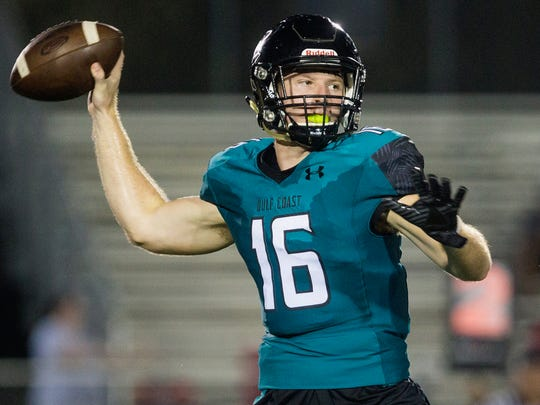 Gulf Coast High School quarterback Kaden Frost prepares to pass the ball at Golden Gate High School in Naples where the Sharks took on the Riverdale Raiders on Thursday, September 28, 2017.
