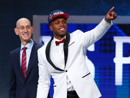 Jun 23, 2016; New York, NY, USA; Buddy Hield (Oklahoma) gestures while next to NBA commissioner Adam Silver after being selected as the number six overall pick to the New Orleans Pelicans in the first round of the 2016 NBA Draft at Barclays Center. Mandatory Credit: Jerry Lai-USA TODAY Sports ORG XMIT: USATSI-269318 ORIG FILE ID: 20160623_jel_sl8_086.jpg