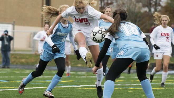 CVU's Sierra Morton (15) leaps to kick the ball during the high school girls soccer playoff game between the Champlain Valley Union Redhawks and the South Burlington Rebels at South Burlington High School on Saturday afternoon.