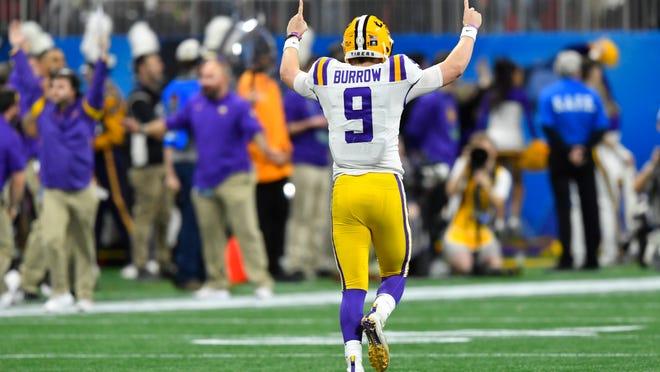 LSU quarterback Joe Burrow (9) celebrates a touchdown against Oklahoma during the first half of the Peach Bowl NCAA semifinal college football playoff game, Saturday, Dec. 28, 2019, in Atlanta. (AP Photo/John Amis)