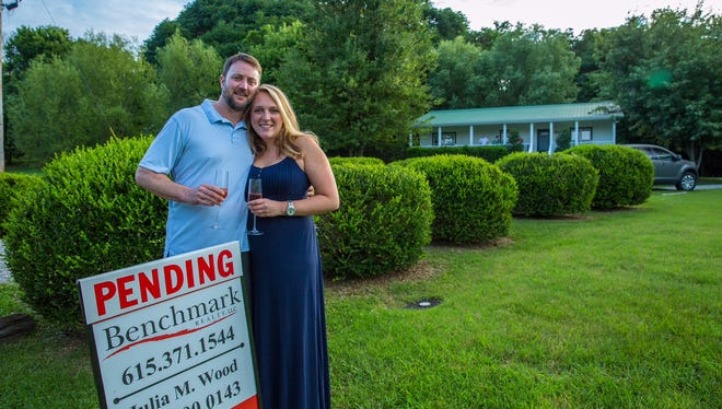 John Baugh proposed to Kathleen Engstrand at their home in Franklin, which they will close on in mid-August.