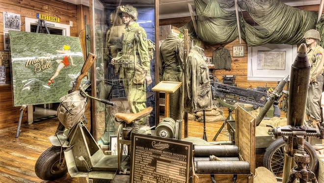 Some of the historical artifacts, uniforms, military photographs, and vehicles on display at the Road to Victory Military Museum, which pays homage to our military heroes.