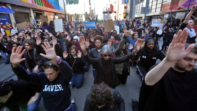 Protesters take to the streets in downtown Cincinnati after a mistrial was declared in the murder trial of former University of Cincinnati police officer Ray Tensing.