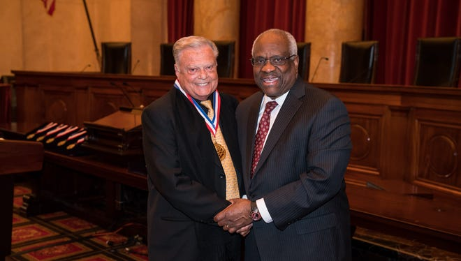 Harold Matzner and Supreme Court Justice Clarence Thomas shake hands in Washington D.C.