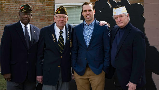 From left: VFW Post 3117 Senior Vice Cmdr. Eloyd Britt; Frank Aleck, Commander, Post 3117; Todd Pagel, Teacher of the Year; and Veterans of Foreign Wars Department of New Jersey Post 3117 Adjutant Ken Durkin.
