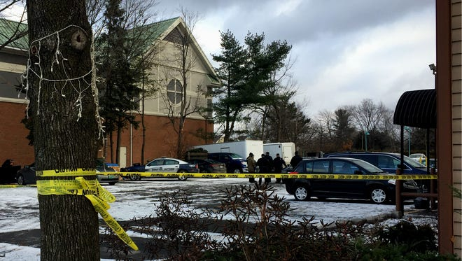 South Burlington Police on Friday, December 9, 2016, investigate the circumstances surrounding the body of a dead man found in the parking lot of The Anchorage Inn on Dorset Street.