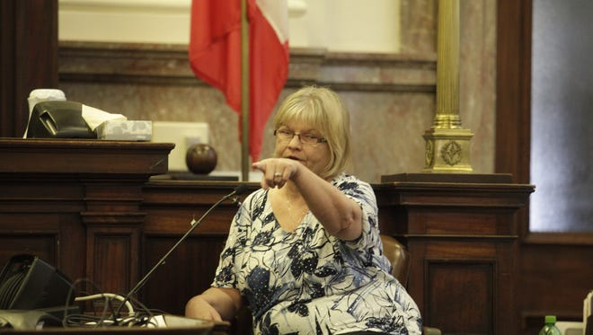 Deana McGillan points at Dr. Daniel Baldi as she testifies against him in his manslaughter trial Monday.