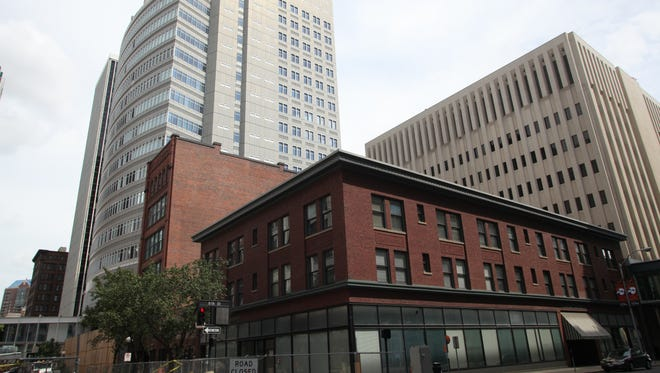 The three-story Foster Building, the six-story Robertson Building and an annex connecting the two will be demolished this fall to make way for a new EMC building.