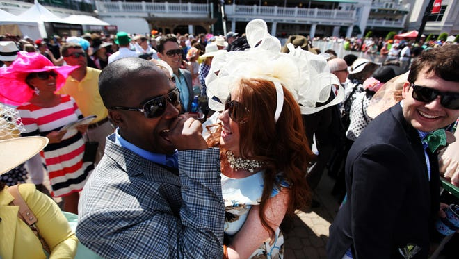 Kevin Tatum and Tiffany Clark celebrate after the horse they bet on, No Surrender, won race number two at the Kentucky Derby.