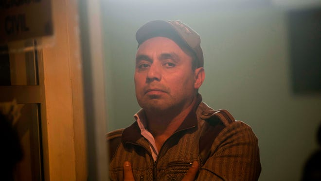 A 2012 file photo shot through a window shows former Guatemalan Army Captain Byron Lima Oliva.
