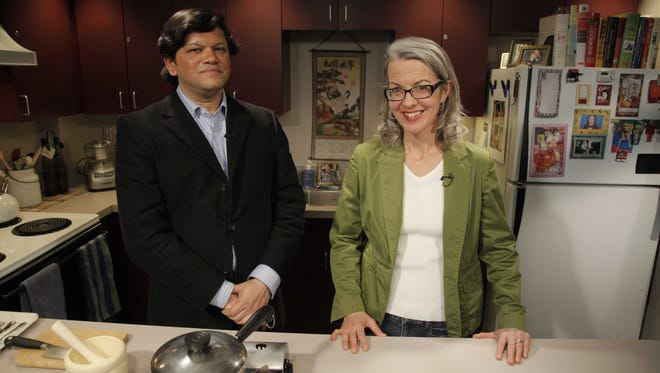 Tuhin Dutta, consulting chef at Amaya Bar & Grill in Brighton, and Karen Miltner discuss spices during a segment of The Clever Kitchen.  Tuhin Dutta, consulting chef of Amaya Bar & Grill in Brighton, films a Clever Kitchen segment with Karen Miltner.