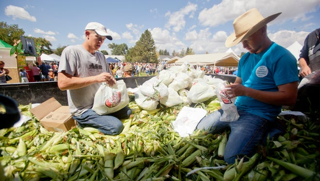 Kyle Staheli and Bryant Gardner, with the Enterprise FFA,  count and bag corn at the Enterprise Corn Fest Saturday, Aug. 23, 2014. Those in attendance enjoyed local entertainment, commercial booths and food. Go to TheSpectrum.com to see the full gallery of the Enterprise Corn Fest.