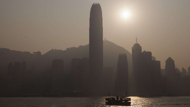 A Star Ferry (bottom) sails in front of the Hong Kong skyline on December 23, 2013.
