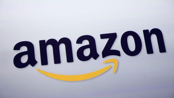 This Sept. 2011 file photo shows the Amazon logo on display at a news conference in New York. Rumors of an Amazon smartphone reached a fever pitch this week, with several tech blogs speculating that the device could be due out this year.