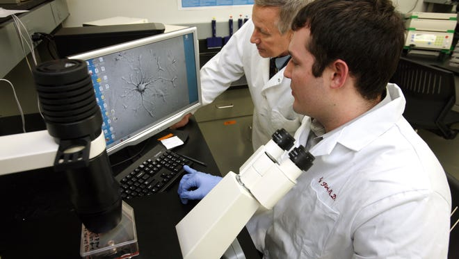 Gary Dunbar and Kyle Fink in the lab at Central Michigan University. Dunbar published the results of some of his research in 2012.