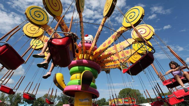 Visitors enjoy rides at the 87th annual Yorktown Grange Fair, Sept. 10, 2011. ( Tania Savayan / The Journal News )