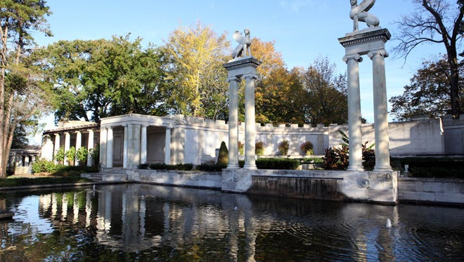 The amphitheater in the walled Greek Garden in Untermyer Park features soaring sphinx sculptures by Paul Manship.