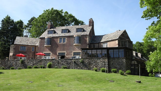 The exterior of this 8,000-square foot house for sale in Croton-on-Hudson, has 36 rooms, 12 bedrooms, 13 bathrooms and 9 fireplaces on 19 acres.