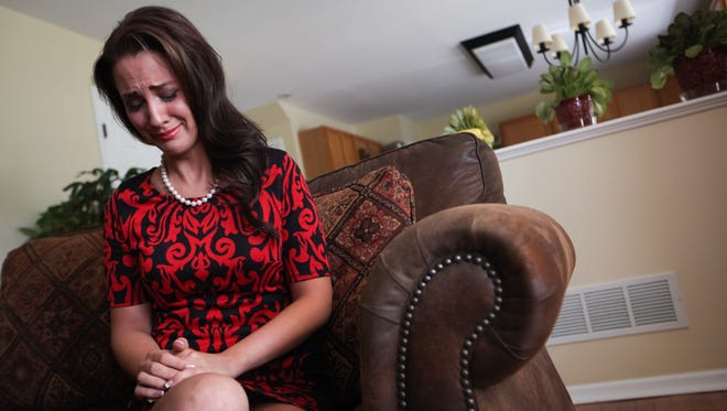 A tearful Amanda Longacre of Bear describes how she was contacted by the Miss Delaware Pageant that she was losing her crown Thursday, June 19, 2014.