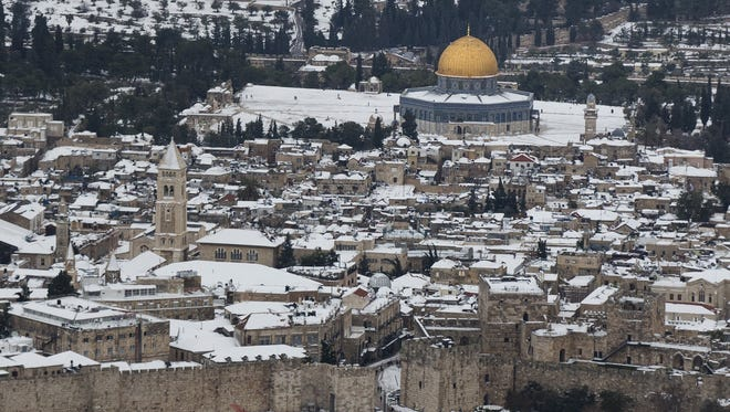 Snow covers Jerusalem's old city on Dec. 14, 2013 in Israel.