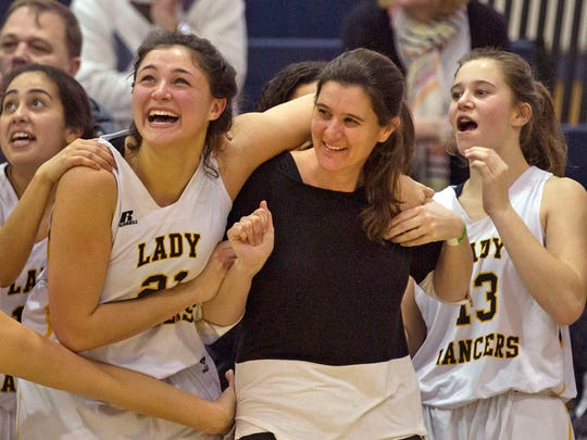 SJV coach Dawn Karpell is swamped by players as the second count down on their Group Championship win. St John Vianney vs Immaculate Heart Academy in Girls NJSIAA Non-Public A Final in Toms River, NJ on March 12, 2016